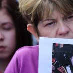 A Loyalist protestor cries as she holds up a picture of IRA victims in Castlederg. Pic: Julien Behal/PA Wire