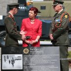 Michael Collins memorial. (LtoR) Chief of Staff of the Defence Forces, Lieutenant General Conor O'Boyle, Michael Collins' grand-niece, Helen Collins and Commander of the Second Brigade, Brian Reade, pictured at a memorial to General Michael Collins at the spot where the iconic photograph of him was taken in August 1922, in Cathal Brugha Barracks just days before he was killed in Cork. The Cathal Brugha Barracks barber, Private Noel McDonnell researched the exact location of the photograph and the memorial was then financed and paid for by the soldiers of the Barracks.  (Laura Hutton/Photocall)<span class=