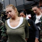 Melissa Reid and Michaella McCollum Connolly taken from the National Police anti-drug headquarters to court. (AP Photo/Martin Mejia)<span class=