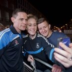 Stephen Cluxton has his picture taken with Ellen Crimmins and Evan Cumiskey.<span class=