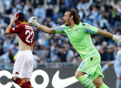 Lazio keeper Federico Marchetti celebrates as Roma forward Mattia Destro despairs at the final whistle of the most recent Rome derby.