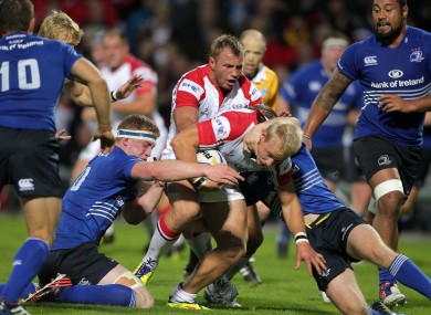 Ulster's Luke Marshall is wrapped up by the Leinster defence.