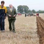 President Michael D Higgins chats with Benny Greene from Ratheniska, who is competing in the Under 28 Conventional Plough Class.<span class=