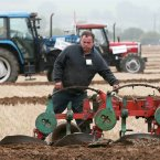 Eamon Meade from Laois who is competing in the 3 furrow conventional match plough class.<span class=