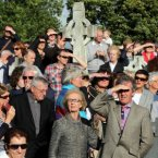 People watch the remains of Seamus Heaney, being carried for burial at St Mary's Church, Bellaghy, Co Derry. <span class=