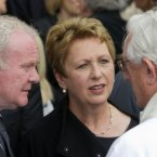 Deputy First Minister of Northern Ireland, Martin McGuinness and former President Mary McAleese speaking with priest.<span class=