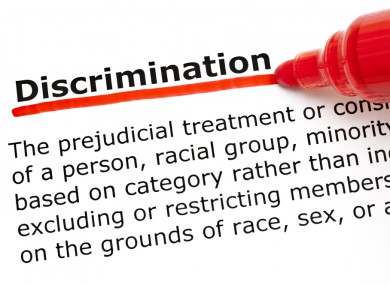 Definition of the word Discrimination underlined with red marker on white paper.