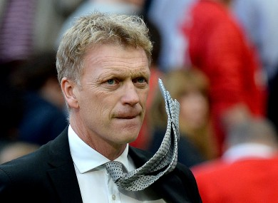 Manchester United manager David Moyes leaves the pitch after his team's 2-1 defeat to West Bromwich Albion on Saturday.