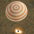 The Soyuz capsule carrying three astronauts has touched down on Earth after undocking from the International Space Station after 166 days in space.<span class=