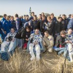 Expedition 36 Flight Engineer Chris Cassidy of NASA, left, Commander Pavel Vinogradov of the Russian Federal Space Agency (Roscosmos), center, and, Flight Engineer Alexander Misurkin of Roscosmos, sit in chairs outside the Soyuz capsule just minutes after they landed.<span class=