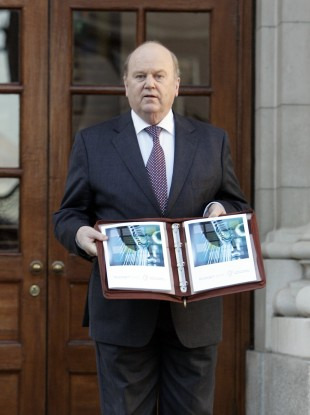 Michael Noonan with his Budget document last year