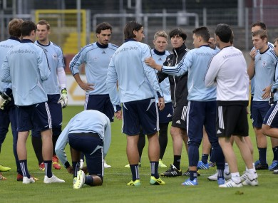 Jogi Low and his players gather at training.
