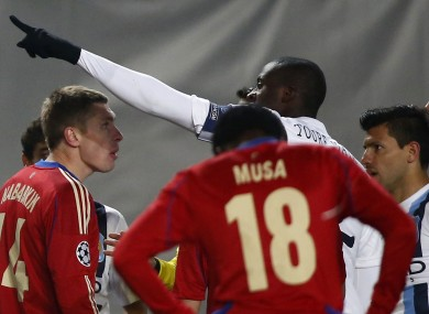 Yaya Toure, centre, pointing towards fans speaks to the referee Ovidiu Hategan, unseen, CSKA's Kirill Nababkin, left, and Musa, back to camera, during the Champions League group D match between CSKA Moscow and Manchester City.