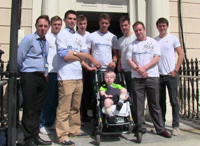 Dominic Ryan (centre) with fellow founders of 100 Minds outside Temple Street Children's Hospital.