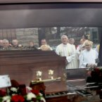 Priests and Altar boys and girls watch the coffin of Fr Alec Reid being driven from Clonard Monastery.<span class=