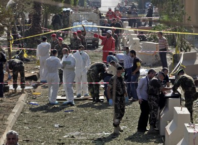 Lebanese army investigators inspect the scene.