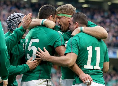 Ireland's Rob Kearney celebrates his try with Jamie Heaslip and David Kearney.