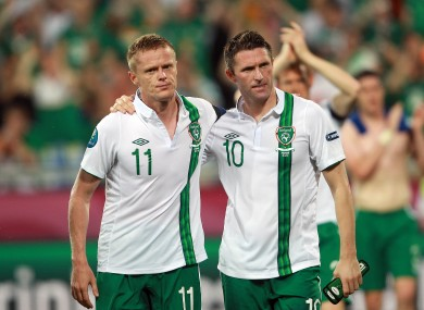 Down and out: Keane and Damien Duff, left, after Ireland's Euro 2012 defeat to Italy in the Municipal Stadium.