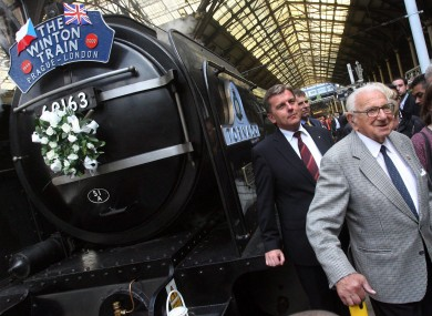 Nicholas Winton, seen here at age 100 in 2009, beside the 'Winton Train' at Liverpool Street Station in London.