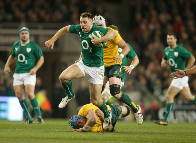 Tommy Bowe vaults over James Horwill.