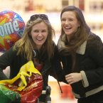 Ciara Meyler from Wexford (left) is welcomed home from Perth for Christmas by her sister Aisling<span class=