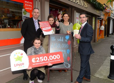 National Lottery Sales Representative Martin Manley congratulates staff at Counihan's Shop, Princes Street, Tralee on the sale of a the prize winning ticket.
