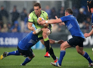 Leinster's Shane Jennings and Aaron Dundon tackle George North of Northampton Saints.
