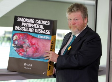 Health Minister James Reilly with an outsize version of the Australian 'plain pack' cigarette box design.