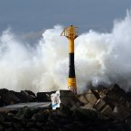 A big wave hits the seawall at the beach in Anglet, southwestern France<span class=