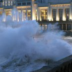 Waves crash on the beach front, outside the Biarritz casino, in southwestern France on 7 January. <span class=