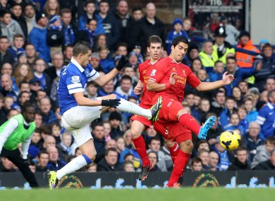 Everton's Kevin Miralles catches Liverpool striker Luis Suarez when the sides met in November.