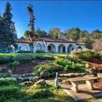 18 million dollars for several detached buildings with 12 bedrooms, 11 baths, stables and orchards.<span class=