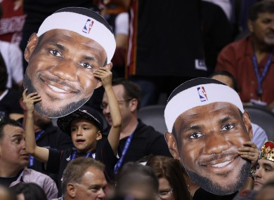 Miami Heat fans cheers on their favorite player, LeBron James.