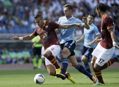 Roma defender Leandro Castan and Lazio striker Miroslav Klose.