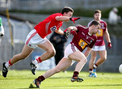 Mark Collins battles Westmeath's Jamie Gonoud for possession.