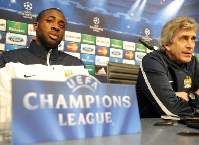 Yaya Toure and Manuel Pellegrini during yesterday's pre-match press conference.