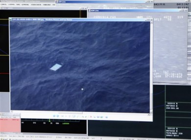Computer monitor onboard shows an object floating in an area within the search zone.