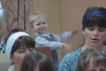 Baby conducts church choir and gets really, really into it
