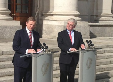Enda Kenny and Eamon Gilmore outside Government Buildings today