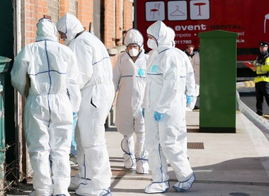 State Pathologist Dr Marie Cassidy and garda officials (File photo)
