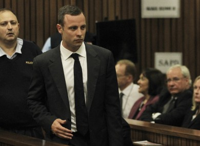Pistorius arrives for his trial at the high court in Pretoria this morning.