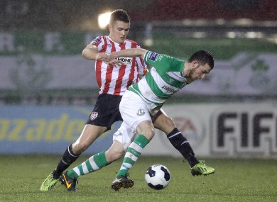 Shamrock Rovers' Ryan Brennan with Michael Duffy of Derry City.