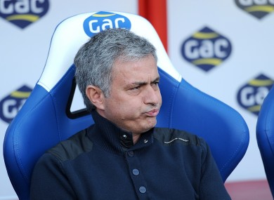 Mourinho watches on during his side's game today.