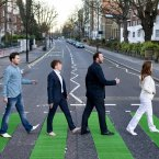 The zebra crossing on Abbey Road, St John's Wood, is turned green by Tourism Ireland to celebrate St Patrick's Day in London.<span class=