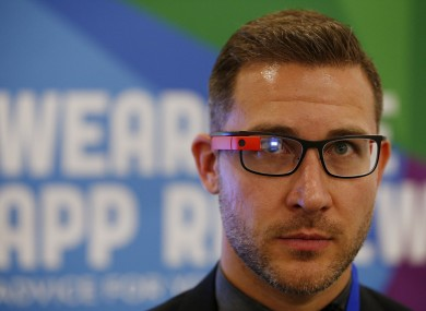 An exhibitor demonstrates Google Glass at the Wearable Technology Show held at Kensington Olympia, London.