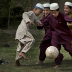 Afghan boys play football during a break at their school in Kandahar, southern Afghanistan.<span class=
