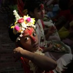 A young girl Hindu girl dressed as