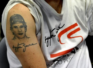A man's tattoo depicting F1 icon Ayrton Senna, in Imola today.