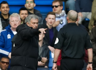 Jose Mourinho exchanges comments with referee Mike Dean.