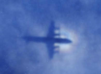 Shadow of a New Zealand Air Force plane searching the Indian Ocean.